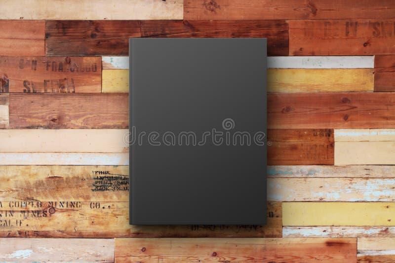 Черная обложка книги на винтажной деревянной поверхности бесплатная иллюстрация