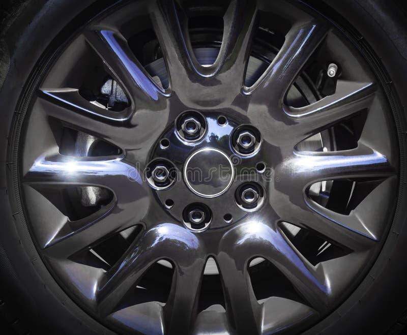 Черная предпосылка оправы сплава автомобиля стоковые изображения