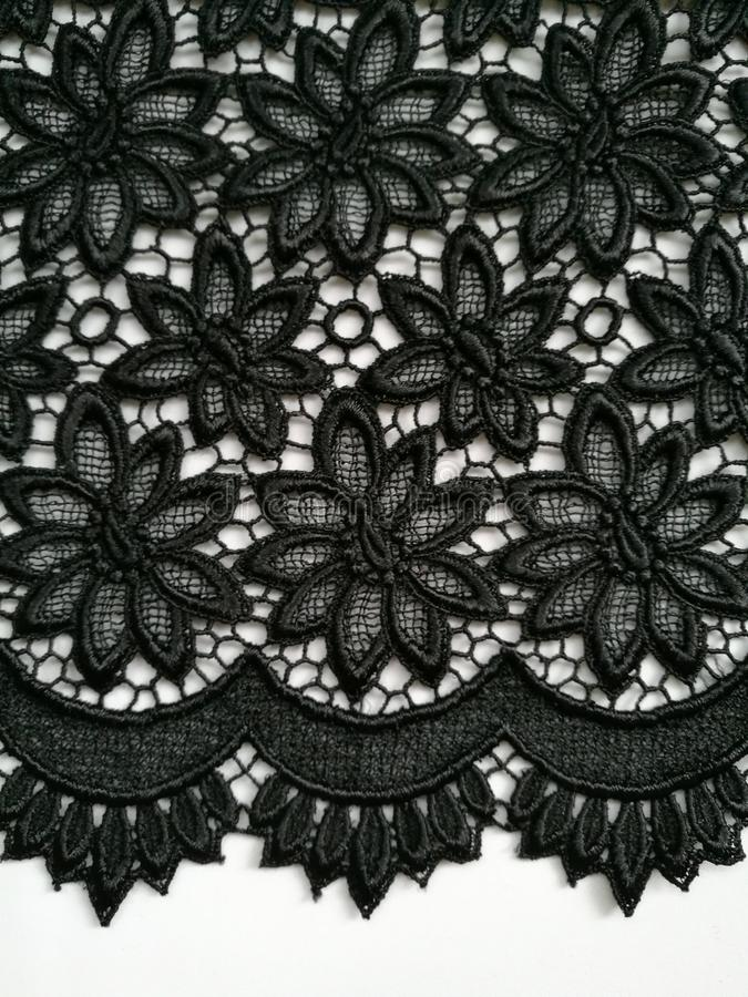 Черная предпосылка текстуры шнурка стоковые изображения