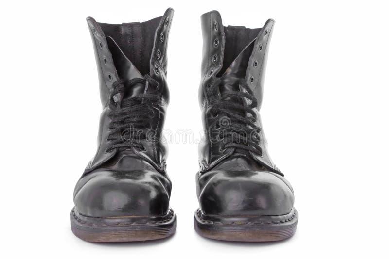 Download черная работа кожи ботинок стоковое изображение. изображение насчитывающей студия - 6853807