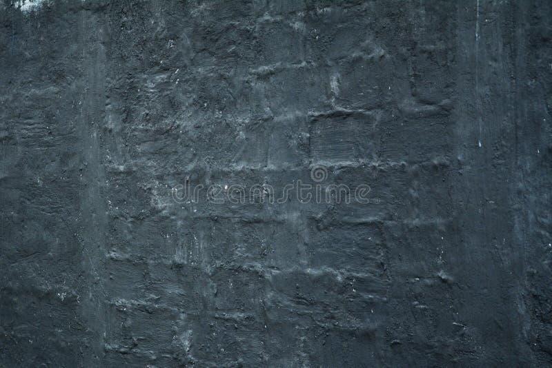 Черная ровная текстура стены стоковая фотография