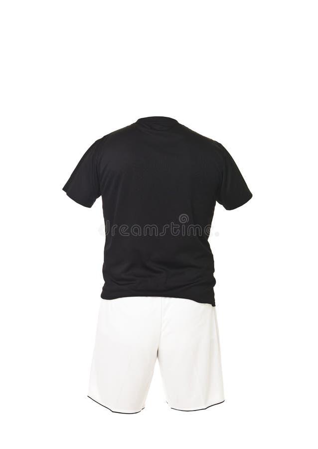 черная рубашка футбола замыкает накоротко белизну стоковые фото