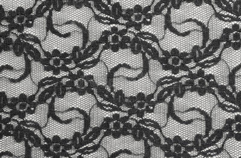 Черная ткань шнурка стоковое фото