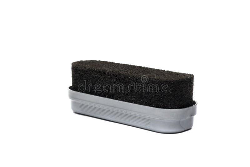Черная щетка для чистки ботинка на белой предпосылке стоковое фото