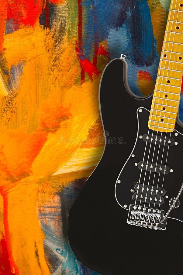 Черная электрическая гитара стоковые изображения