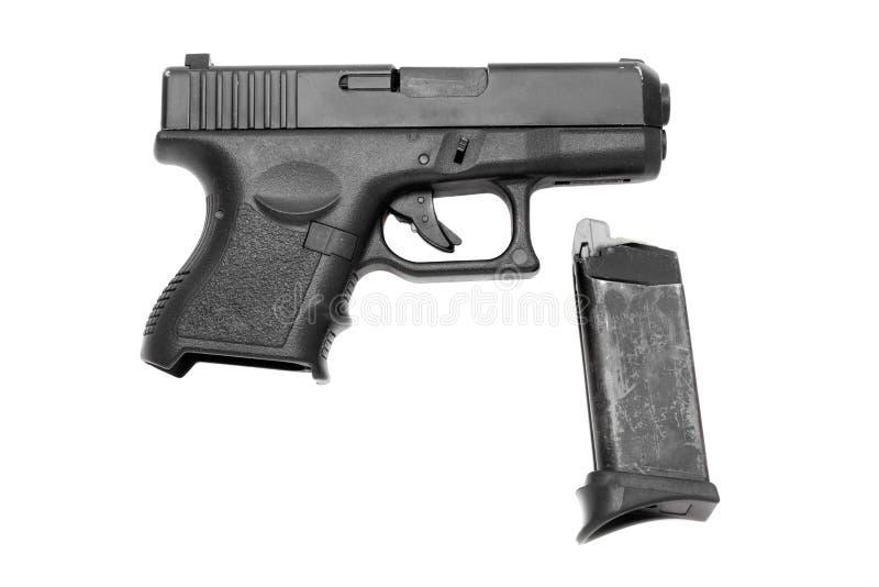 Download Черное оружие с кассетой стоковое фото. изображение насчитывающей обеспеченность - 41657844