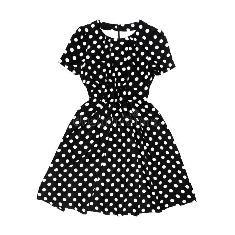 Черное платье точки польки ретро на белой предпосылке стоковая фотография rf