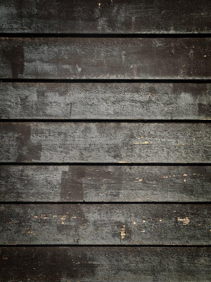 черное grunge обшивает панелями древесину стоковая фотография