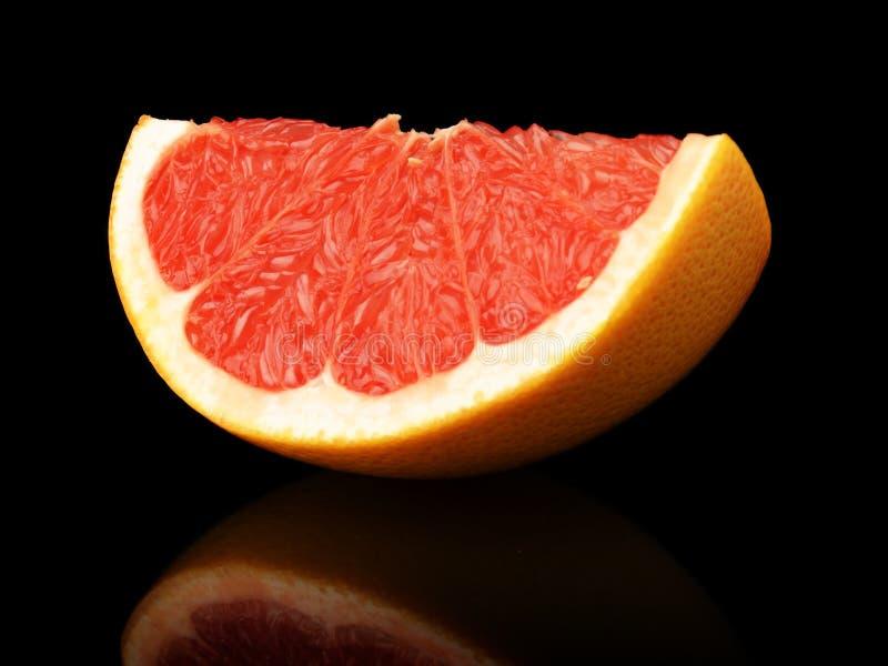 Чернота квартала съемки студии изолированная грейпфрутом стоковая фотография rf