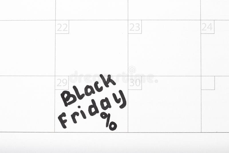 Чернота пятница надписи на календаре 2019 и и знаке процентов, конец-вверх стоковое фото