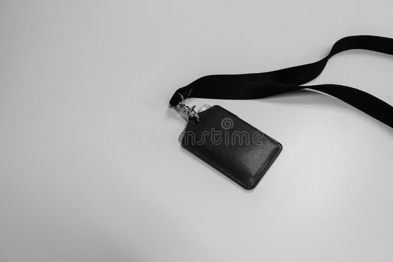 Черно-белая нагрудная планка с фамилией участника шеи компании для доступа и безопасности стоковые изображения