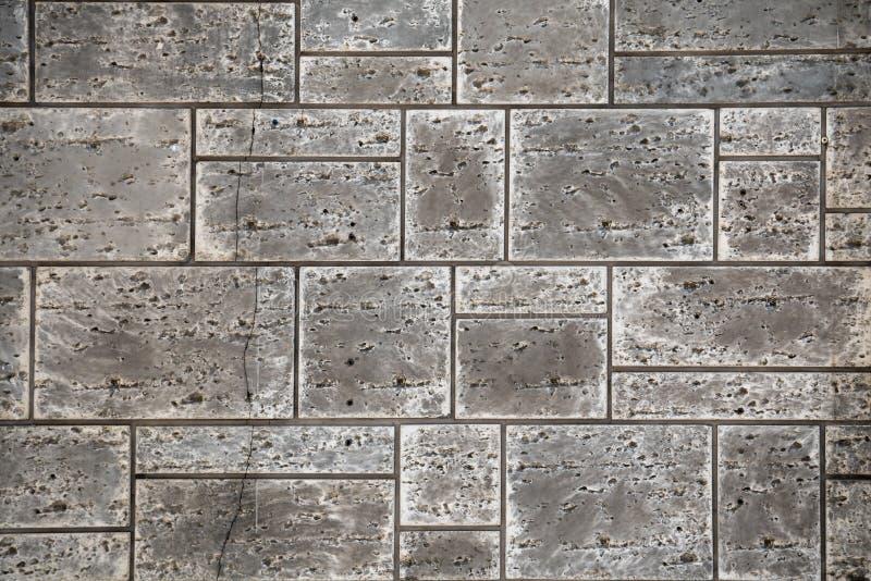 Черно-белый тон апельсина природы и коричневой предпосылки текстуры кирпичной стены, материала конструкции индустрии стоковые фото