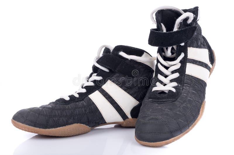 Черно-белые ботинки спорта стоковое изображение