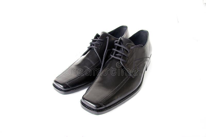 черные ботинки стоковые фото