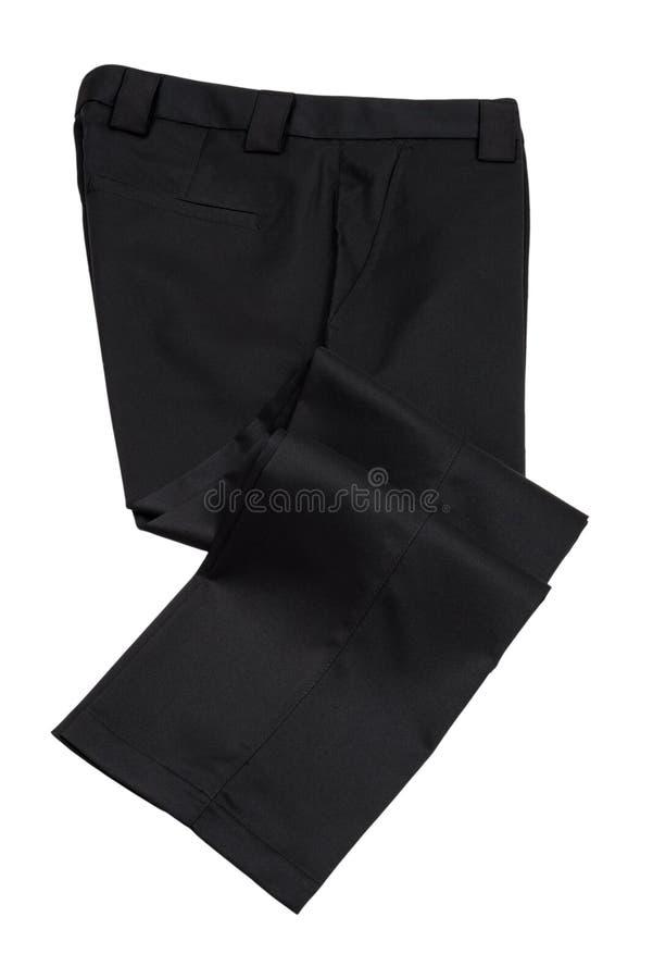 Черные брюки, брюки на белой предпосылке стоковые фотографии rf