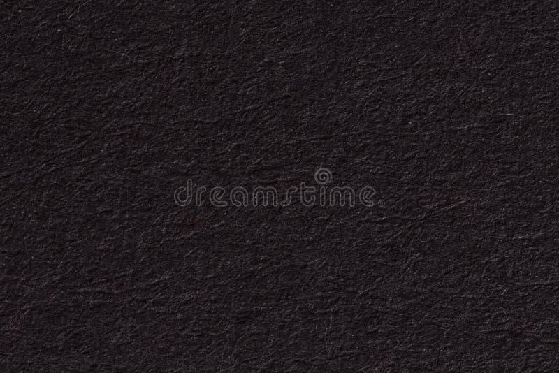 Черные бумажные предпосылка или текстура с виньеткой стоковое фото