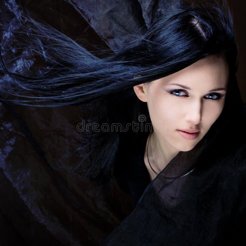 черные волосы голубых глазов стоковое фото