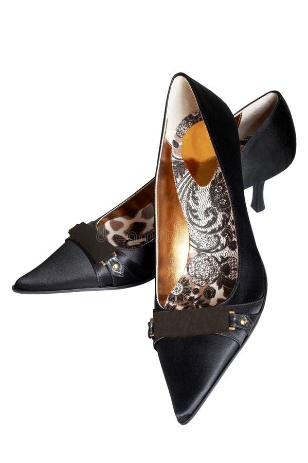 Черные женские ботинки стоковые фотографии rf
