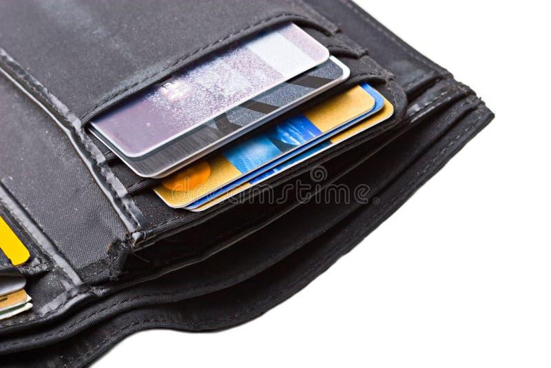 черные карточки закрывают кредит изолированный вверх по бумажнику стоковая фотография rf