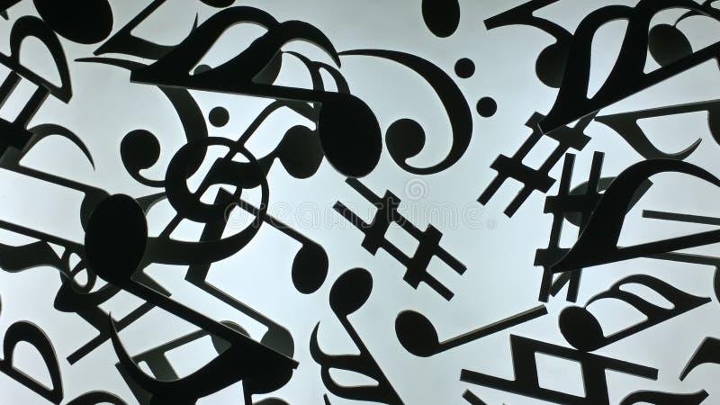 Черные музыкальные знаки на белой предпосылке стоковые фото