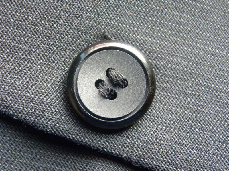 Черные 4 отверстия шьют через кнопку стоковое фото