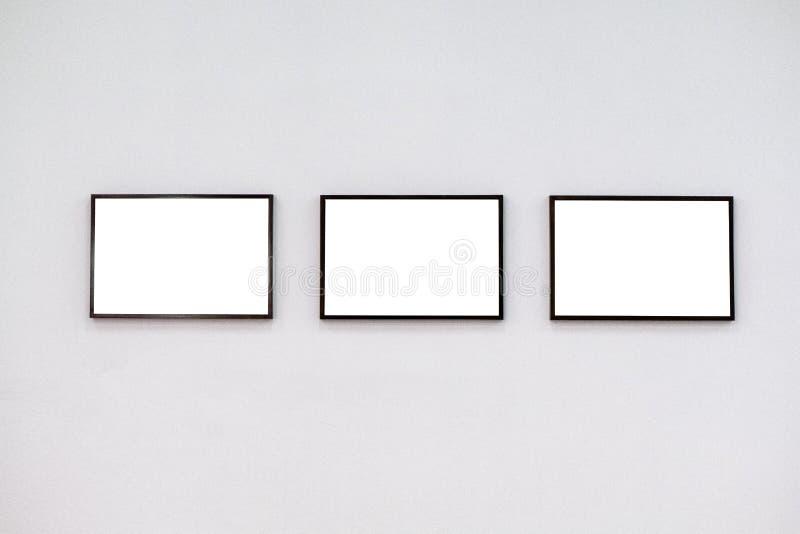 Черные рамки на рамках предпосылки белизны на белой предпосылке стоковая фотография