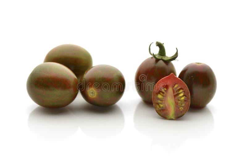 Черные томаты зебры стоковые изображения