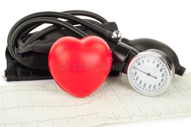 Черные tonometer и сердце, cardiogram стоковая фотография