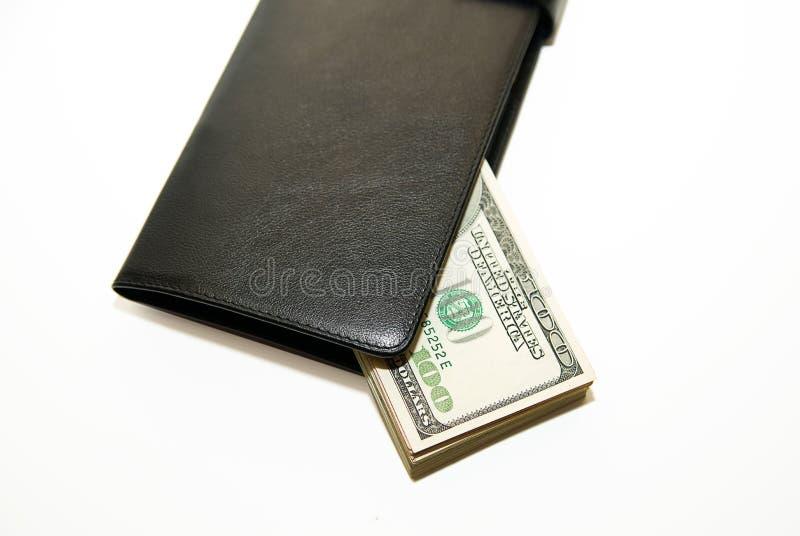 Черный бумажник с банкнотами долларов США внутрь стоковые изображения rf
