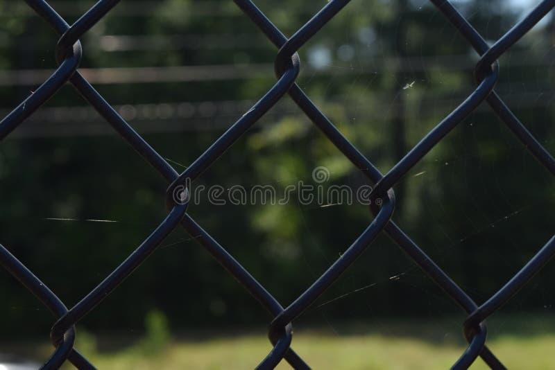 Черный близкий снимок загородки стоковая фотография