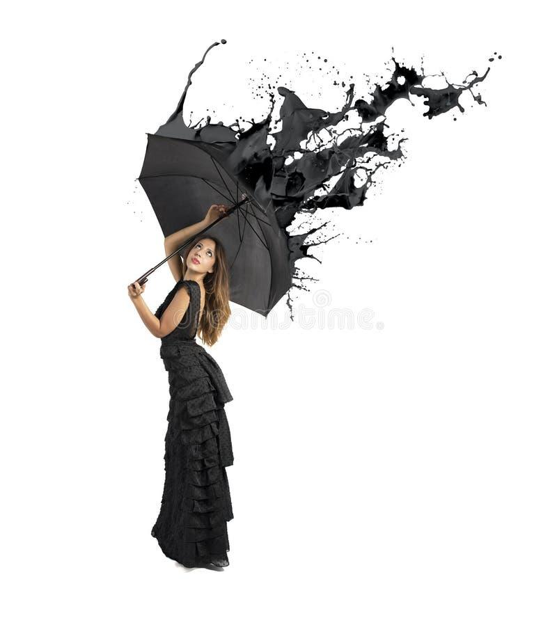 Черный выплеск цвета стоковое фото
