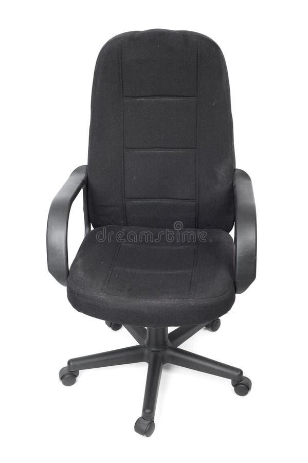 Черный используемый стул офиса ткани стоковое фото