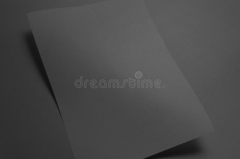 Черный модель-макет плаката A3 - волнистый стоковое фото rf