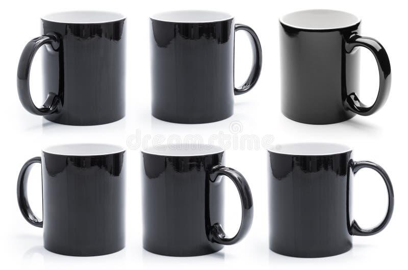Черный набор кружек стоковое изображение rf