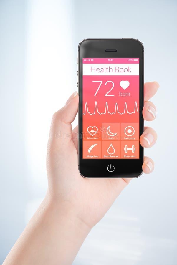Черный передвижной умный телефон с книгой app здоровья на экране в f стоковое фото rf