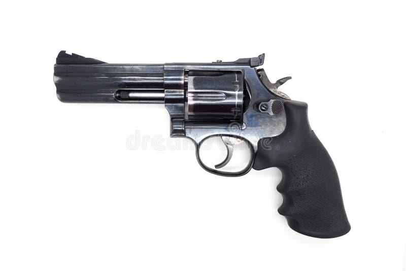 Черный револьвер изолированный на белой предпосылке стоковое изображение