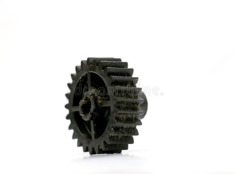 Черный старый пластичный пакостный cogwheel стоковое изображение