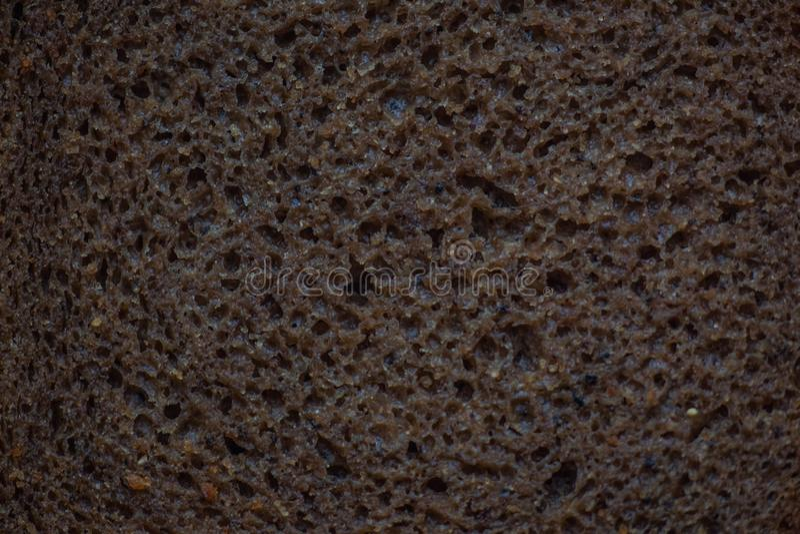 Черный хлеб дрожжей рож, часть, текстура теста стоковое фото rf