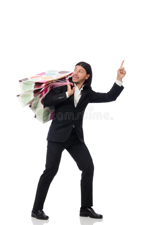 Черный человек костюма держа полиэтиленовые пакеты изолированный на белизне стоковые фотографии rf