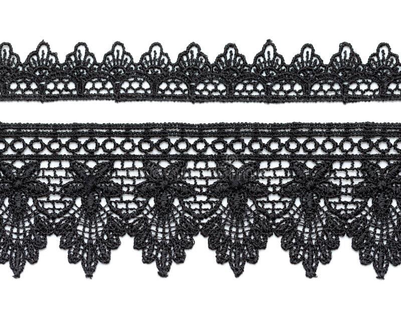 Черный шнурок сатинировки. стоковые изображения