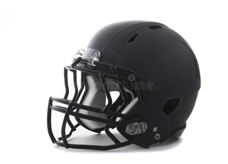 Черный шлем футбола на белизне стоковая фотография rf
