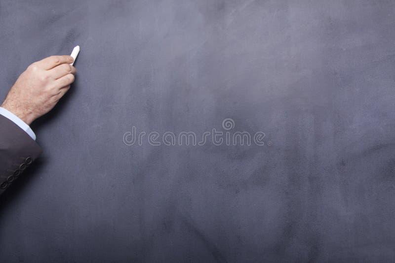 Чертеж бизнесмена на классн классном стоковая фотография