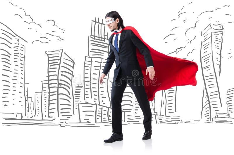 Человек в красной крышке с skyscapers на предпосылке стоковые изображения
