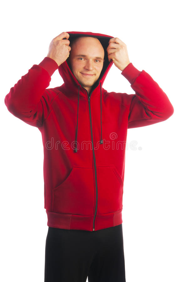 Человек в красной куртке при молния принимая клобук стоковая фотография