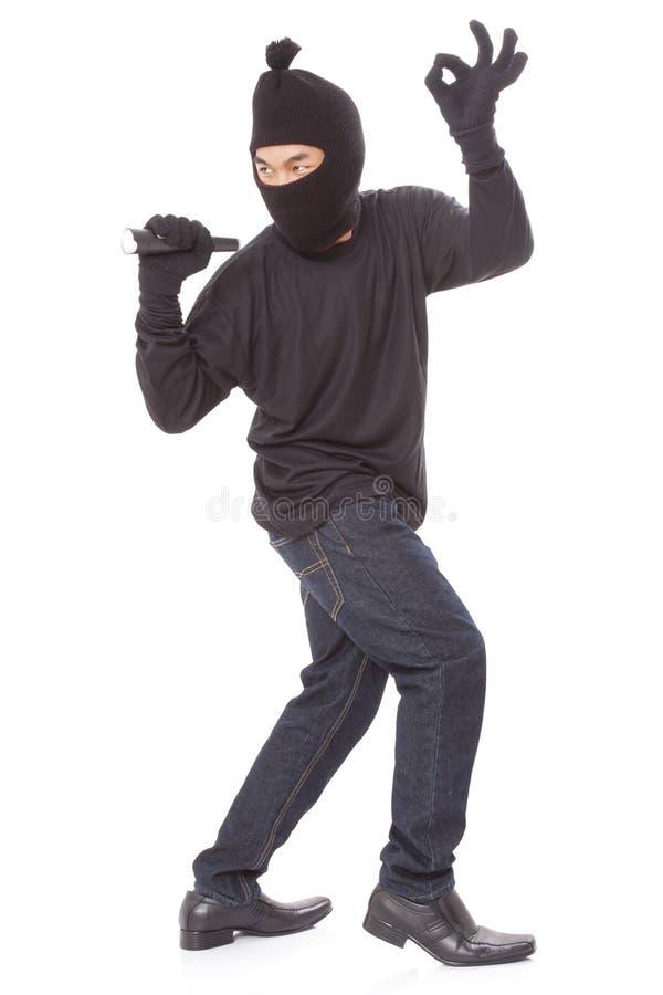 Человек в маске держа электрофонарь стоковая фотография rf