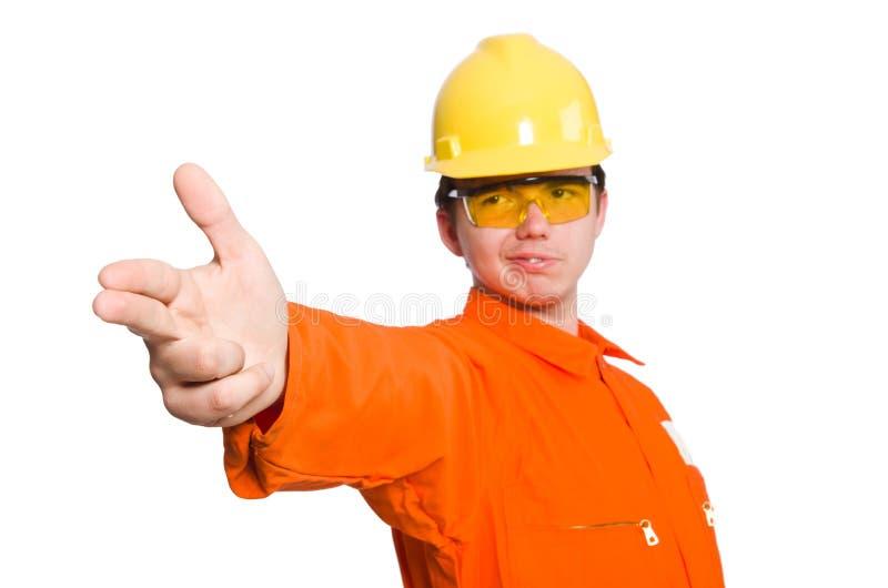 Человек в оранжевых coveralls изолированных на белизне стоковое изображение