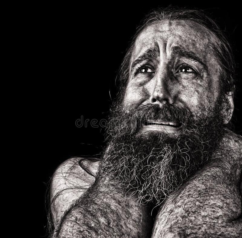Человек в разрывах стоковое фото