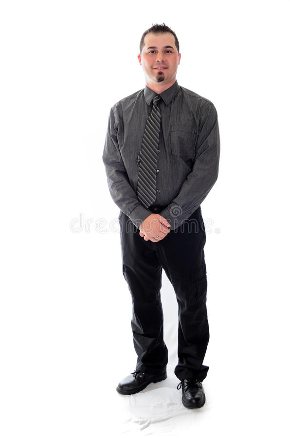 Человек в рубашке и связь держа его усмехаться рук стоковая фотография rf