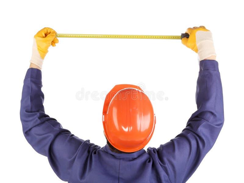 Человек в шлеме конструкции. стоковые фото