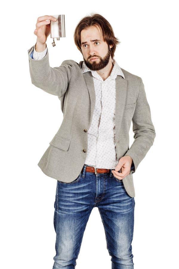 Человек держа склянку спирта стоковое фото